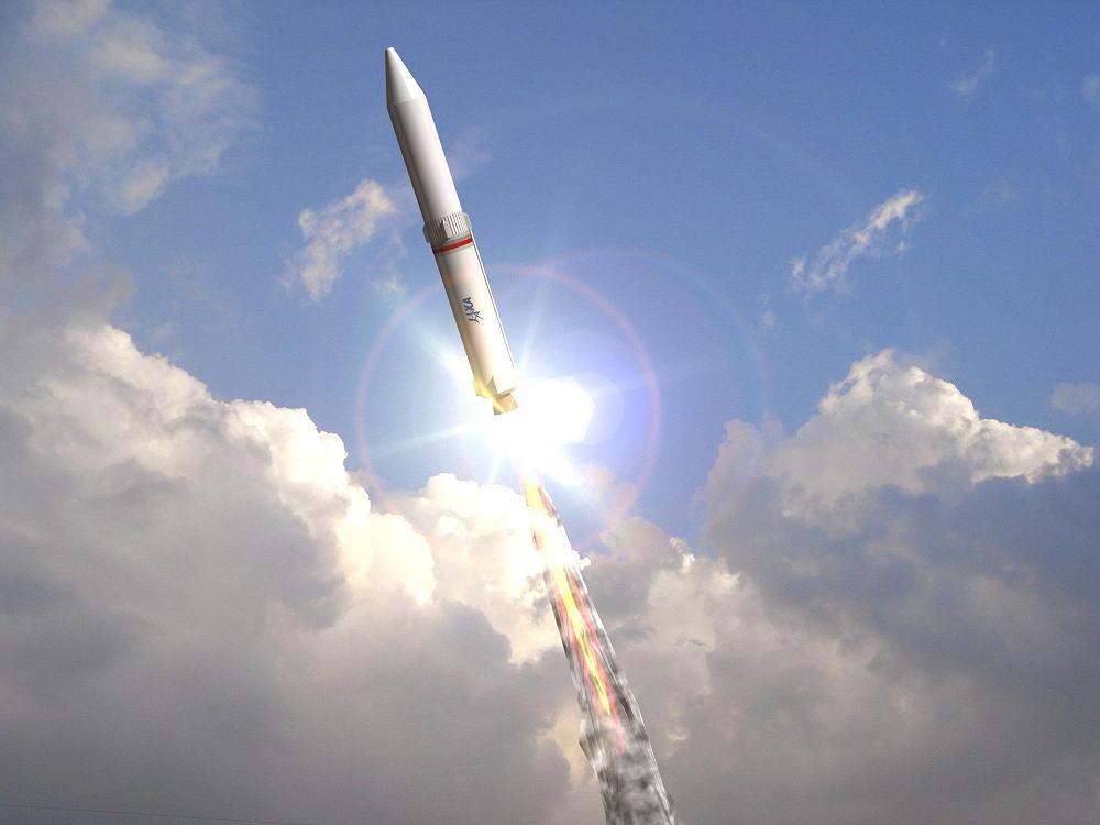 太陽に反射するスペースシャトル